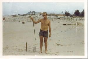 Craig Venter: Craig Venter on a beach in Vietnam with a sea snake