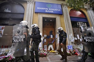 24 Hour Protest: Riot policeman at scene of the fire in 24 hour protest in Athens, Greece
