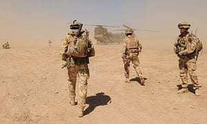 British soldiers walk towards a military helicopter in Helmand province, Afghanistan