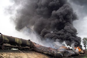 24 hours in pictures: West Champaran, India: Oil wagons on fire after being derailed