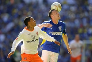 Play Off Final: DJ Campbell is beaten to the ball by Anthony Gerrard