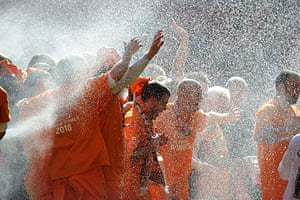 Play Off Final: The champagne comes out as the players celebrate