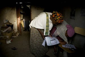 Ethiopia elections: Women mark their votes at a polling station in the village of Debre Zeyt