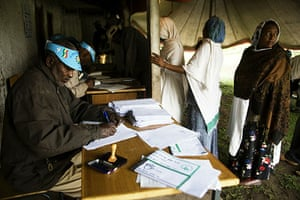 Ethiopia elections: Poll station workers process registered voters wanting to cast their vote
