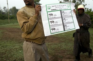 Ethiopia elections: An election worker holds up a ballot at polling station