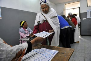 Ethiopia elections: An Ethiopian woman gets ballot papers at a polling station in Addis Ababa