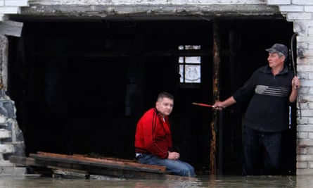 Residents wait for help in a flooded area of Iuliszew, near Plock, in Poland.