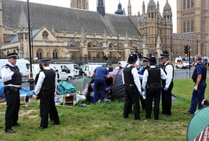 state opening: Police officers enter the Democracy camp in Parliament Square
