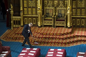 state opening: The carpet is cleaned in front of the Queen's throne in Westminster