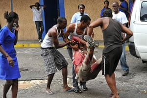 Jamaica: People carrying a wounded person to the public Kingston hospital