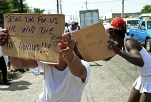 """Jamaica: Demonstrators in support of Christopher """"Dudus"""" Coke during a march"""