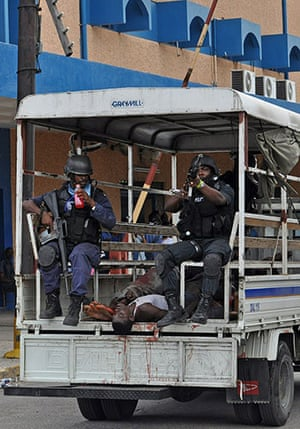jamaica violence: Police at Kingston hospital with the dead bodies of suspects