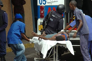 jamaica violence: An injured man is taken to the Public Hospital in Kingston, Jamaica