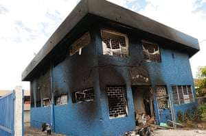 jamaica violence: The burnt-out police headquarters on Darling street, Kingston, Jamaica