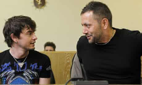 Defendants Anton Robert K. (R) and Murat