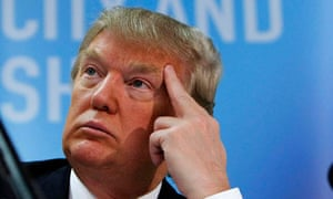 U.S. businessman Donald Trump listens during a news conference at Aberdeen Airport in Scotland