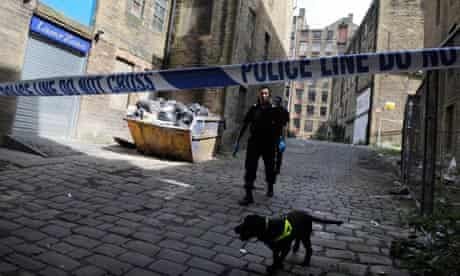 Police search an alley off Thornton Road in Bradford