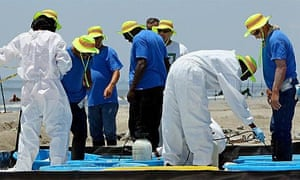 Oil spill, beach cleaners
