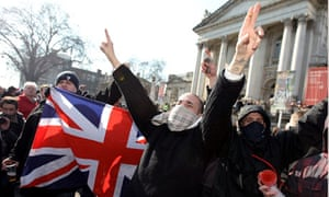 English Defence League members attend a march