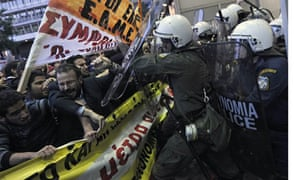 Protesters clash with riot police in Athens