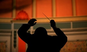 A conductor directs his musicians as they play in the Buxton Brass Band Festival.