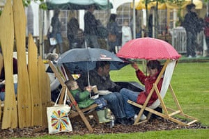 Hay Festival: People carry on and picnic during a very heavy downpour