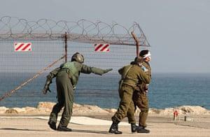 Gaza convoy attack: Israeli soldiers evacuate an injured comrade to a hospital in Haifa