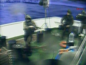 Gaza convoy attack:  Israeli soldiers aboard a military vessel in international waters