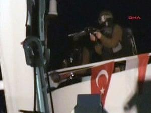 Gaza convoy attack: An Israeli commando as he lands on a Gaza-bound ship