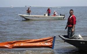 Deepwater Horizon oil rig: Oil spill : Local fishermen load oil booms