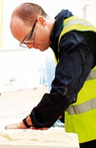 Oliver Burkeman cutting stone