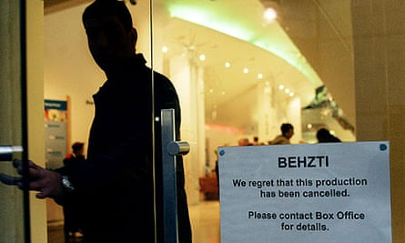 A man exits the Repertory Theatre after cancellation of the play Behzti in Birmingham