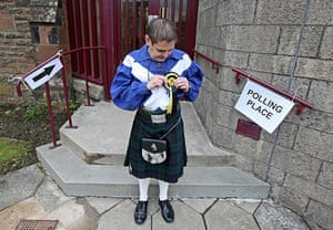 Polling: A voter leaves Westpark church in Denny, Scotland