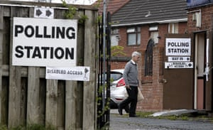 Polling: A voter arrives at the Reigate Social Club in  Halewood, Knowsley