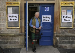 Polling: A voter leaves a polling station at Pitlochry Town Hall, Scotland