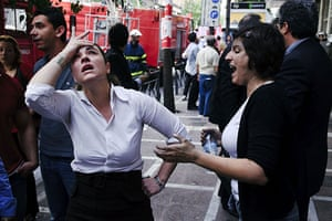 Greece Rioting: Bank employee's watches as their colleagues are rescued from fire in Athens