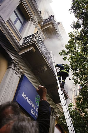 Greece Rioting: Firemen rescue bank employee's of the Marfin-Egnatia Bank in Athens