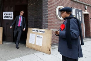 Voting Gallery: Man leaves a polling station after voting in south London