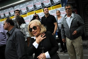 Greece Riots: A woman looks at the Marfin bank where three people were killed
