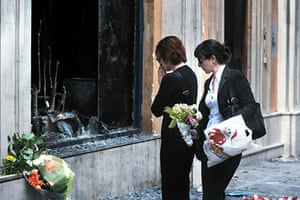 Greece Riots: Women put flowers in front the bank
