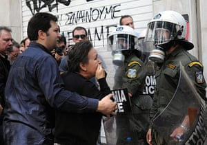 Greece Riots: A relative of a bank employee outside the torched bank