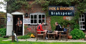 Voting updated: Men sit outside The Fox and Hounds pub polling station in Christmas Common