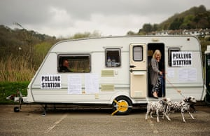 Voting updated: A woman votes in a caravan in cornwall