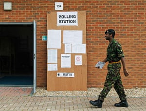 Voting updated: A soldier from the Royal Artillery arrives to cast his vote