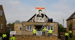 Voting updated: Police erect a ladder to remove protestors on the roof of a polling station