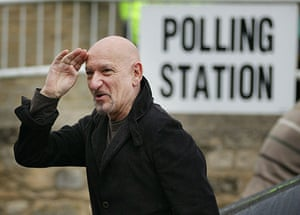 Voting updated: Ben Kingsley gestures as he arrives at the polling station in Spelsbury