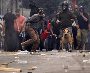 Greek riots dog: 5 May: Demonstrators throw stones at the police in central Athens