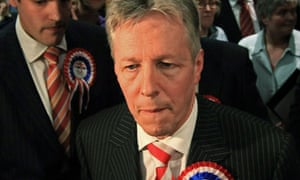 Northern Ireland's first minister, Peter Robinson, reacts after losing his Belfast East seat