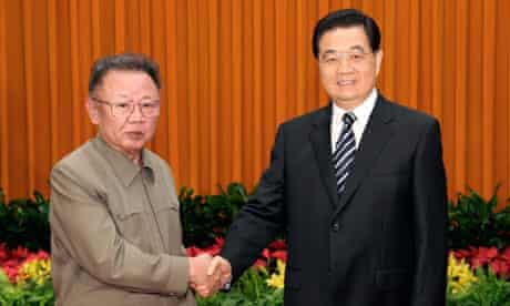 China's President Hu Jintao shakes hands with North Korean leader Kim Jong-il