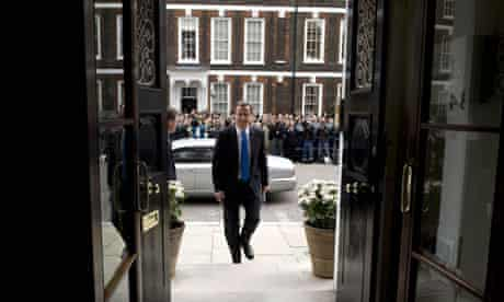 David Cameron arrives for a press conference after the election result